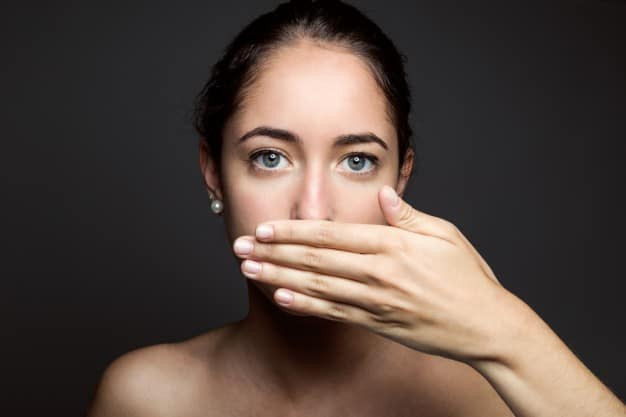 beautiful-young-woman-covering-her-mouth-with-hand-isolated_1301-4025