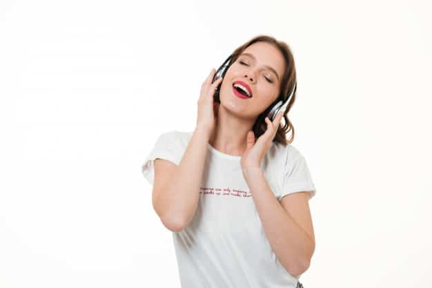 portrait-happy-girl-listening-music-with-headphones_171337-11553
