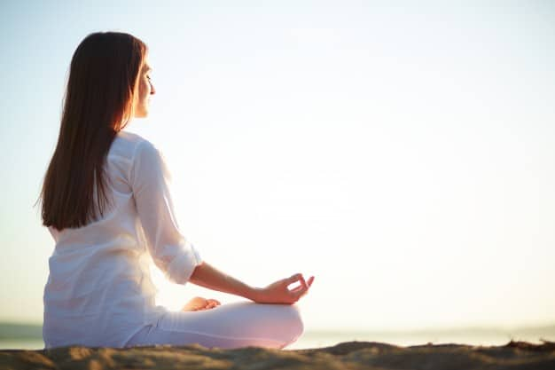 woman-sitting-yoga-pose-beach_1098-1454