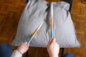 Playing drum sticks to master drumming