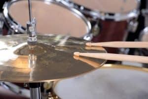 drum set sticks and a disc