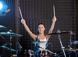 girl playing drum as a workout