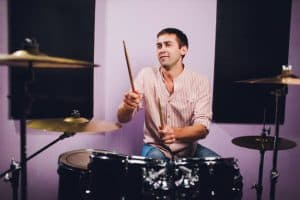man playing a drum in a recording studio