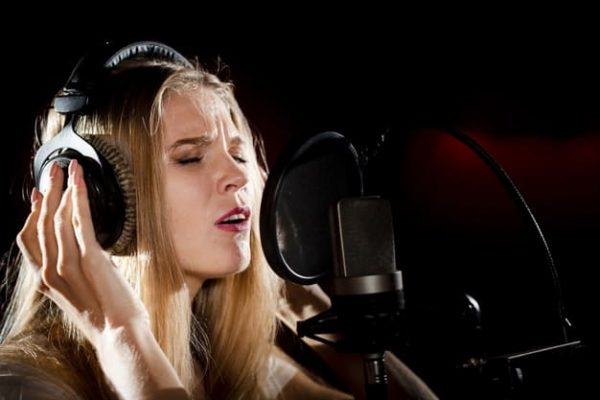 close-up-woman-with-headphones-singing_23-2148366446