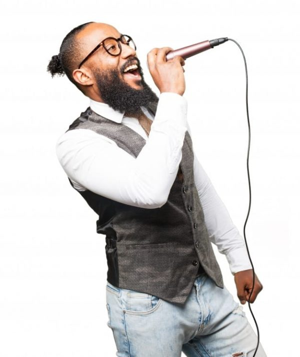 man-singing-through-microphone-with-his-mouth-open_1187-2865