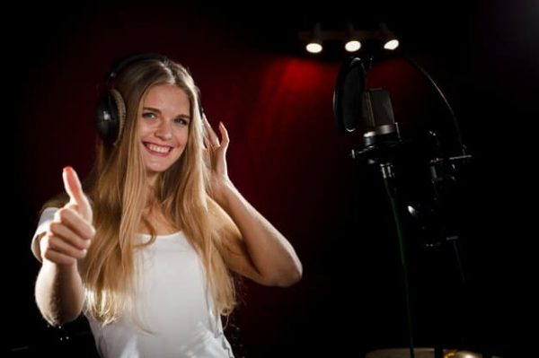 woman-wearing-headphones-showing-thumbs-up_23-2148366445