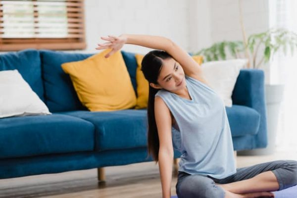 young-asian-woman-practicing-yoga-living-room_7861-1617